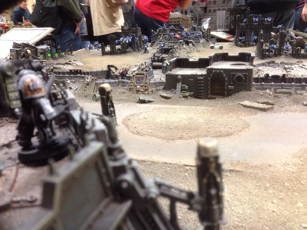 The Techmarine picks the next target for his orbital bombbardment