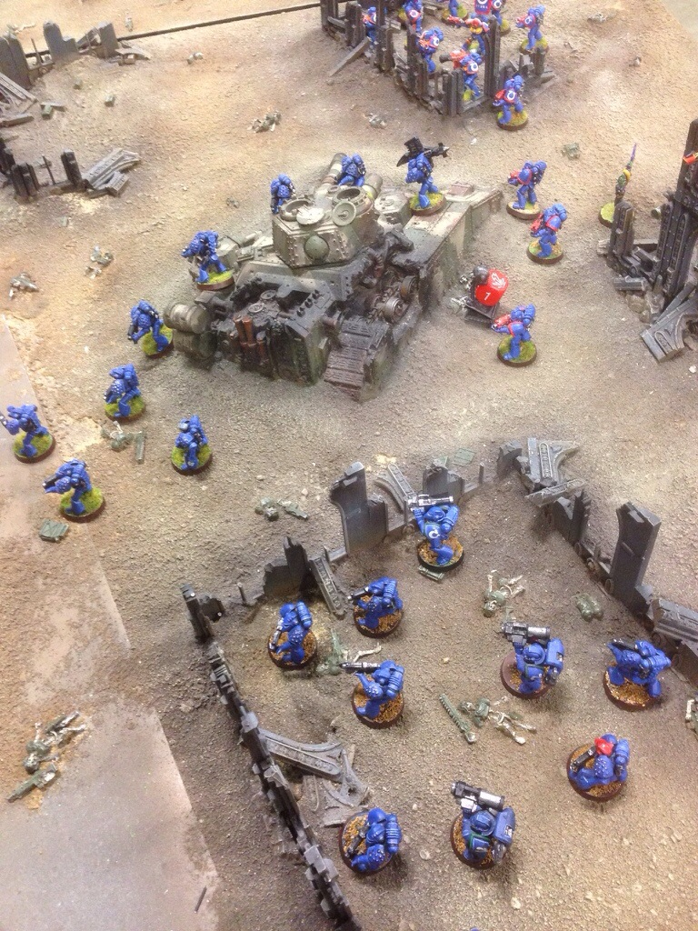 The assassin shoots at the Space Marines before moving in for the kill.