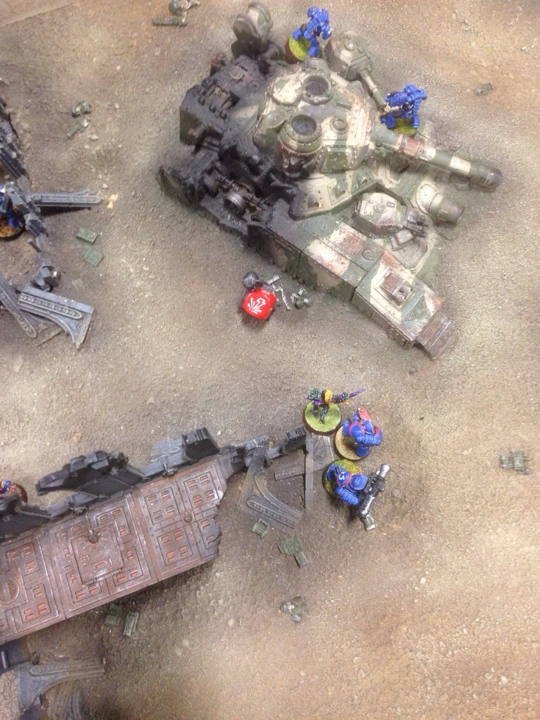 The Ultramarines fight bravley against an assassin