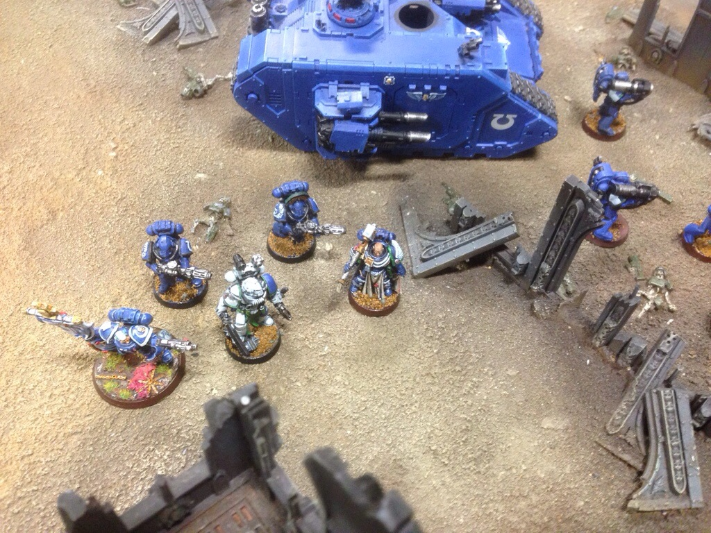 Captain Ben Jackson leaves his Landraider to claim an objective.